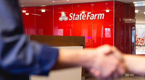 People shaking hands in a State Farm office