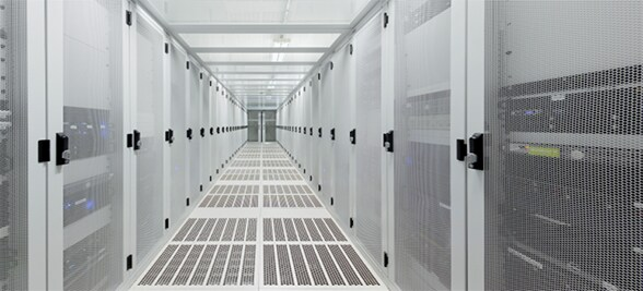 Corridor lined with series of servers
