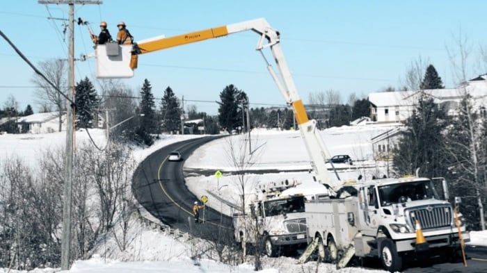 Utility linemen working in winter