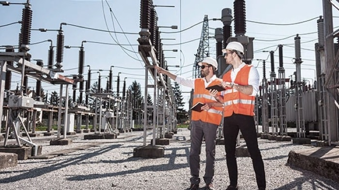 Workers at electric substation