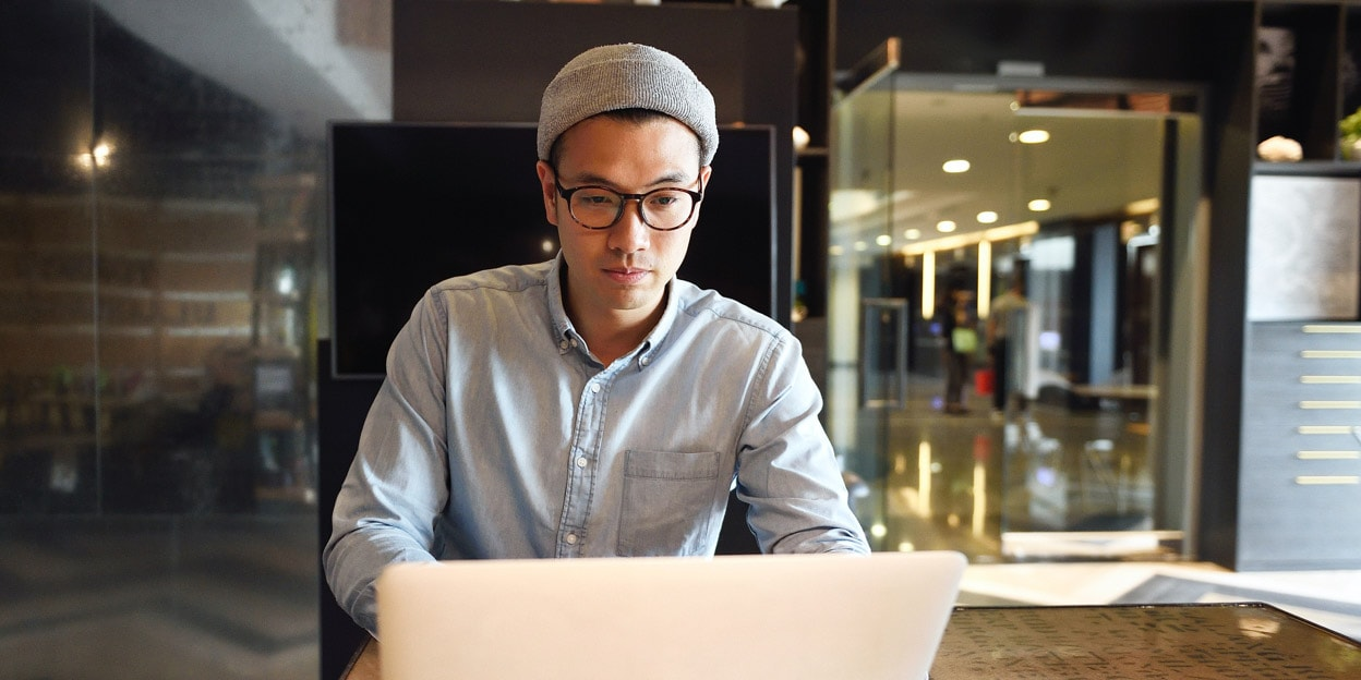 A man looking at a laptop screen