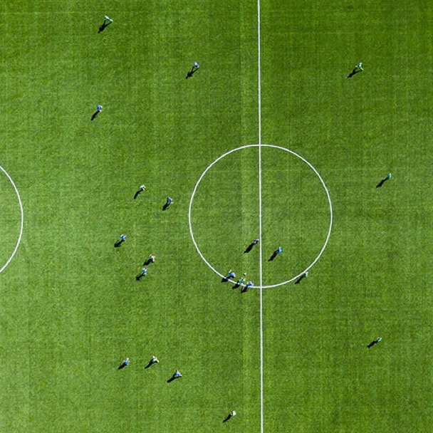 Aerial view of a soccer field with players