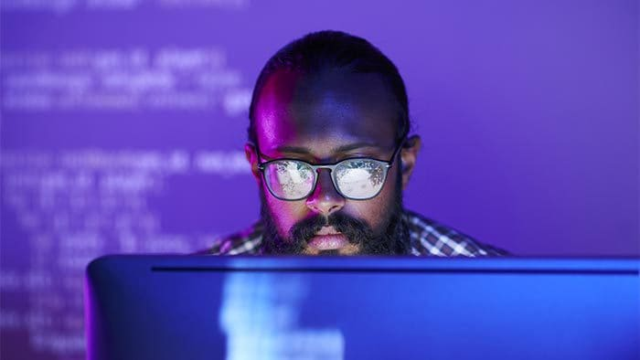 Man staring at the screen of a laptop computer