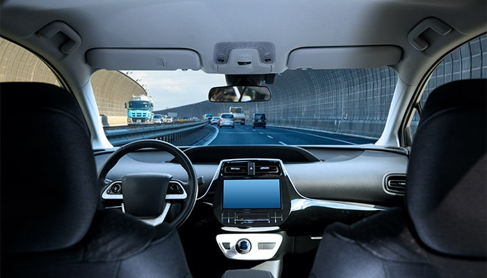 Interior of self-driving connected vehicle on highway