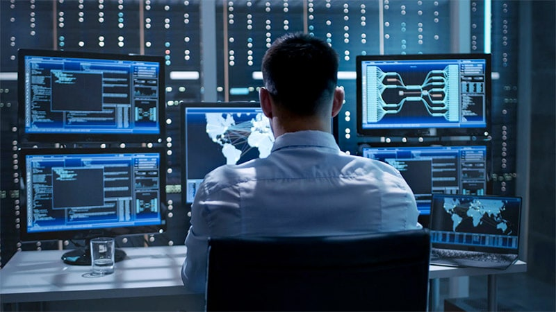 Image of man working in a security operations center
