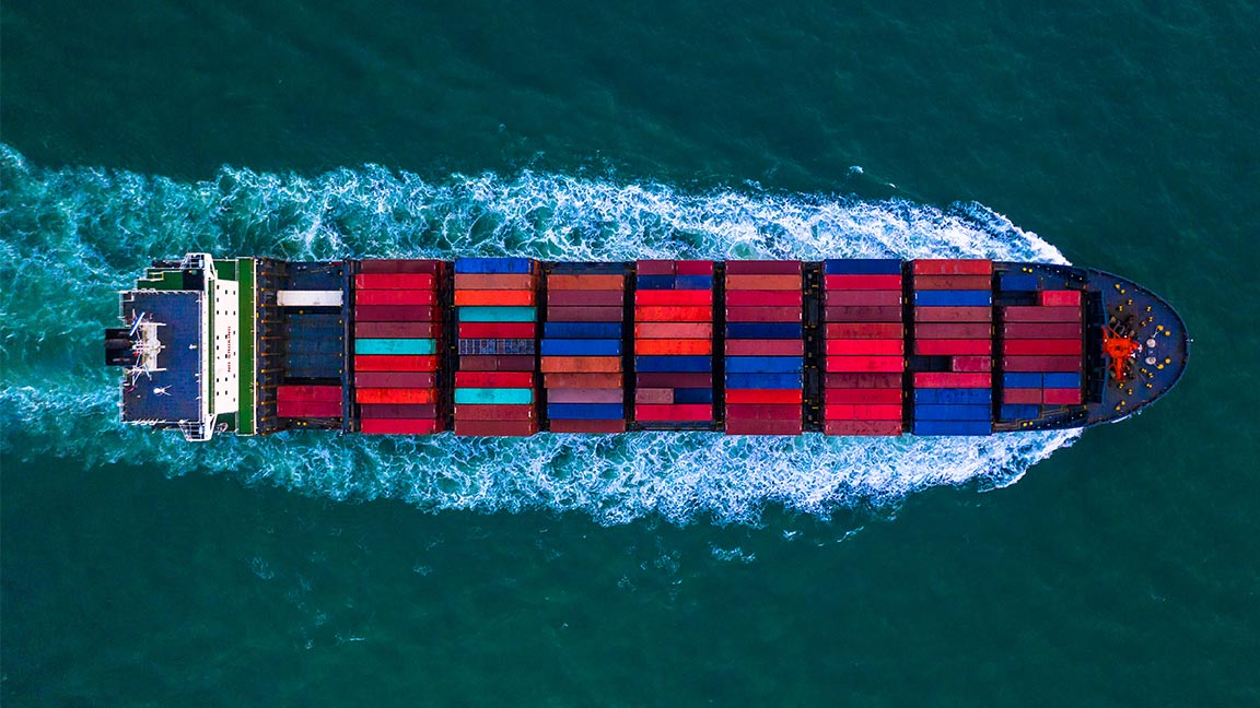 Container ship underway at sea, seen from above