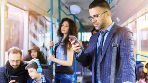 people in public transportation using smart devices