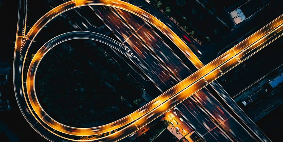 time-lapse aerial photo of curved highway