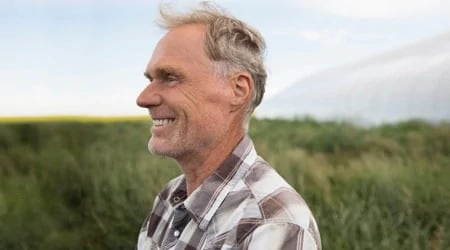 Man smiling in a field