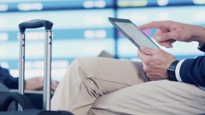 Man using tablet in airport