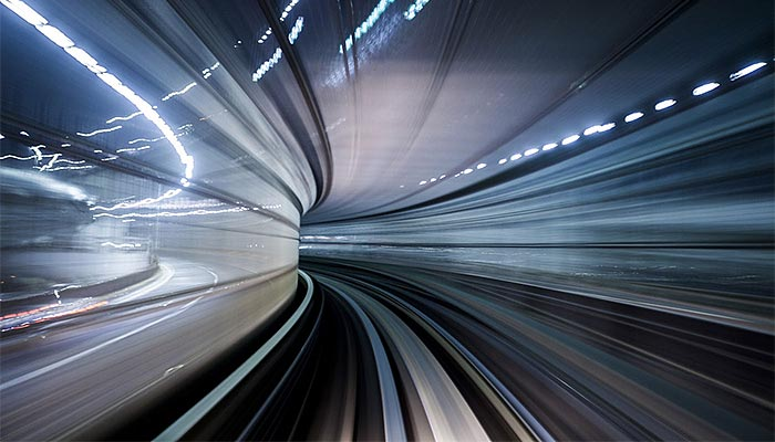 Motion blurred image of lights in a tunnel