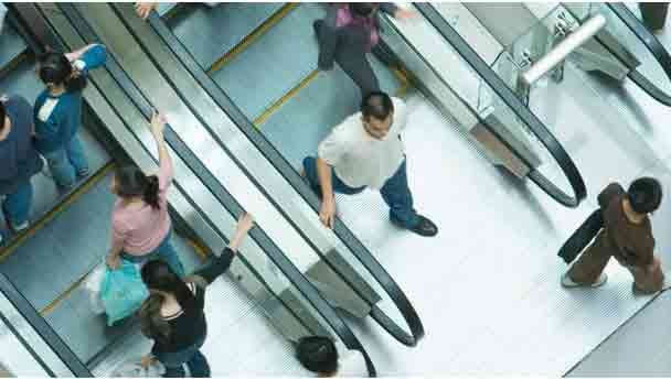 People on escalators to depict consumers benefitting from automation
