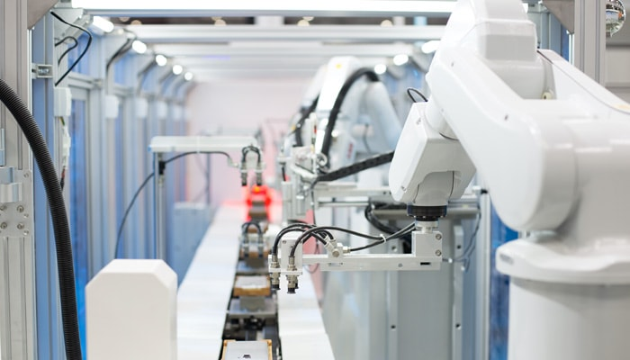 Robots in a manufacturing plant