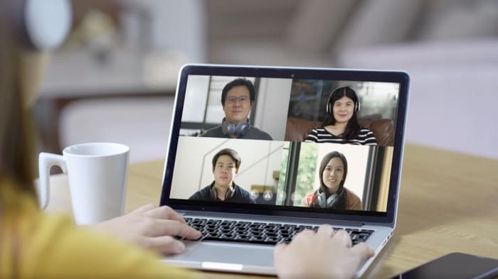 A monitor displaying a videoconference meeting