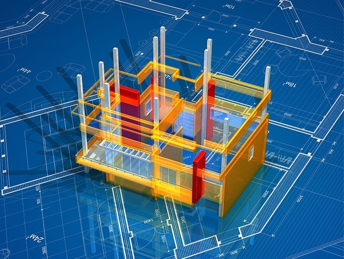 Three-dimensional model of building, sitting on blueprints