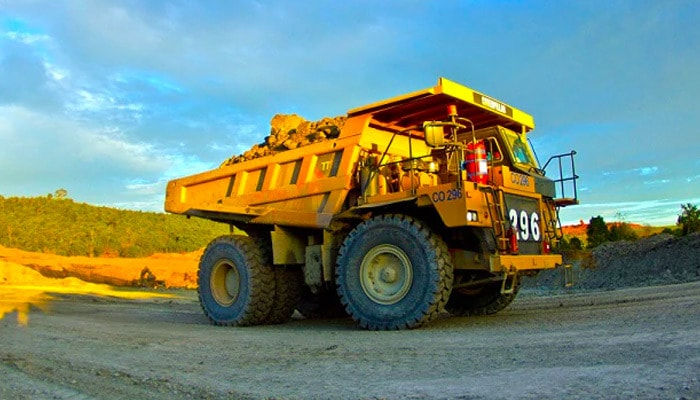 Large dump truck moving dirt
