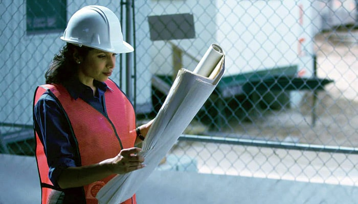 Area worker looking at diagrams