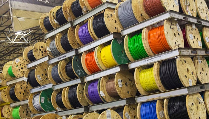 Rows of colored cable lines rolled up