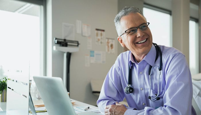 Man sitting at desk smiling