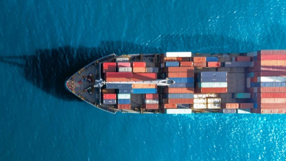 Aerial view of a cargo ship, loaded with containers