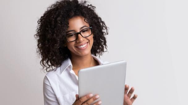 Smiling woman holding tablet