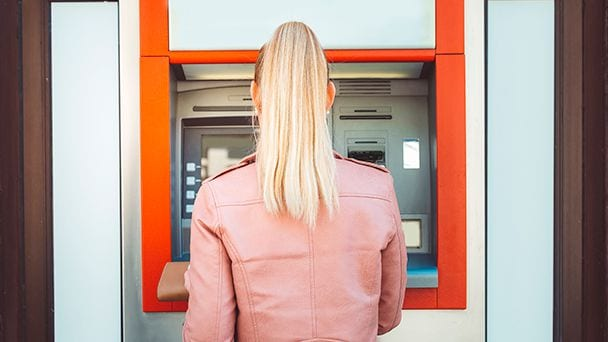 person using an ATM