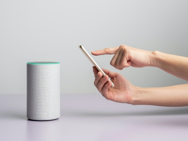 Using a smartphone to control a smart speaker