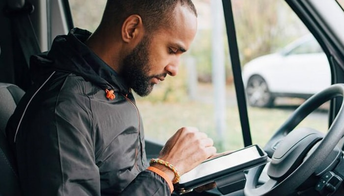 Man using a tablet inside a van