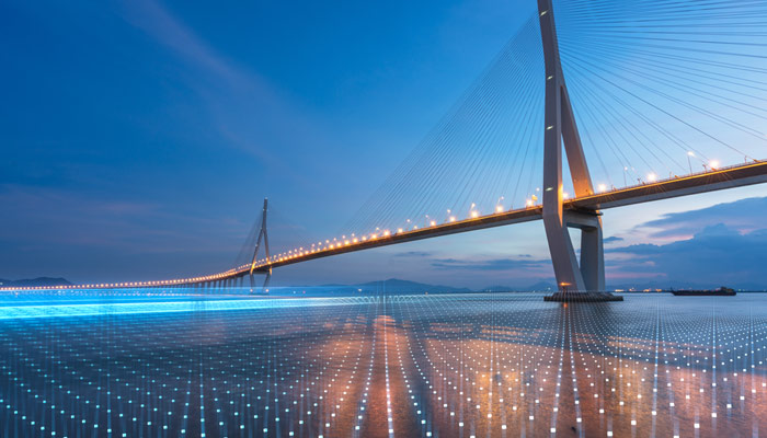 Lighted bridge with blue background