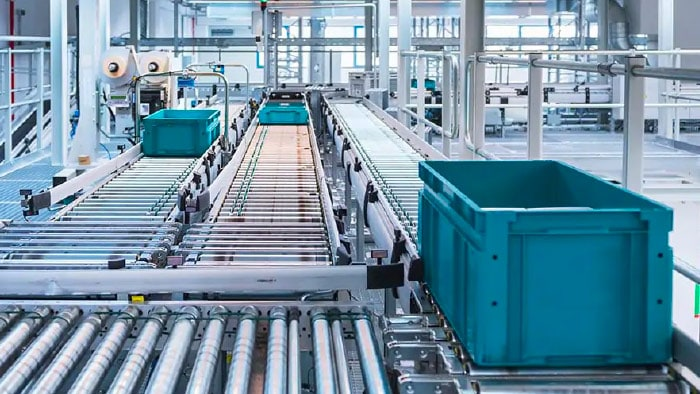 Automated factory with conveyor systems and moving bins