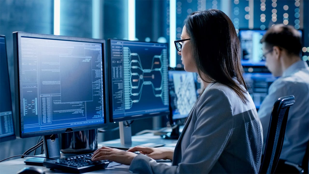 Screen shot of woman using a computer taken from Commercial International Bank S.A.E. case study