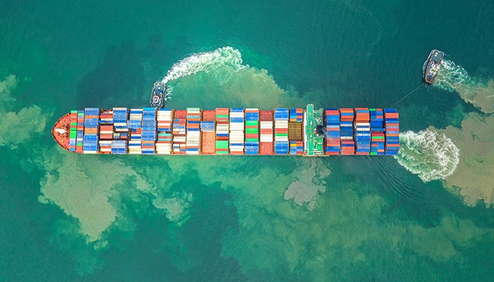 Overhead view of colorful containers on ship in green water