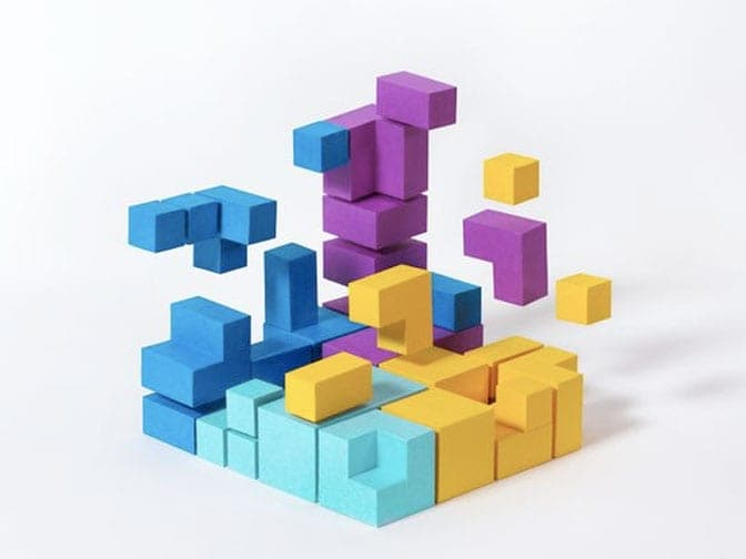 An arrangement of three-dimensional, multi-colored blocks and pieces