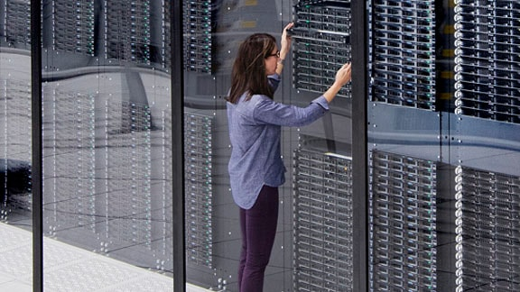 Woman working on mainframe computers