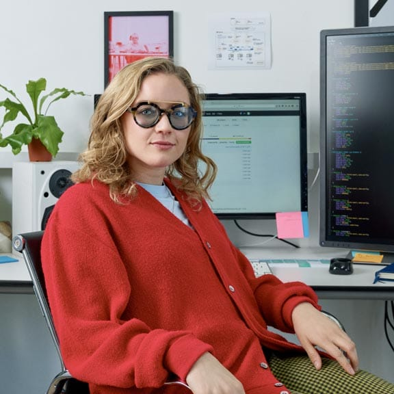 Person at desk with two monitors