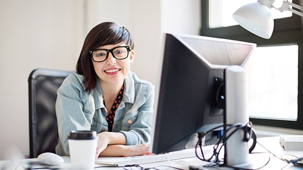 Person sitting at office desk with computer