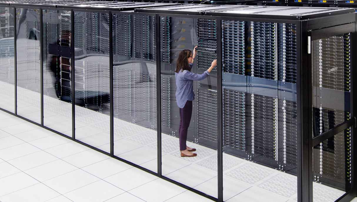 Person working in a glass server room