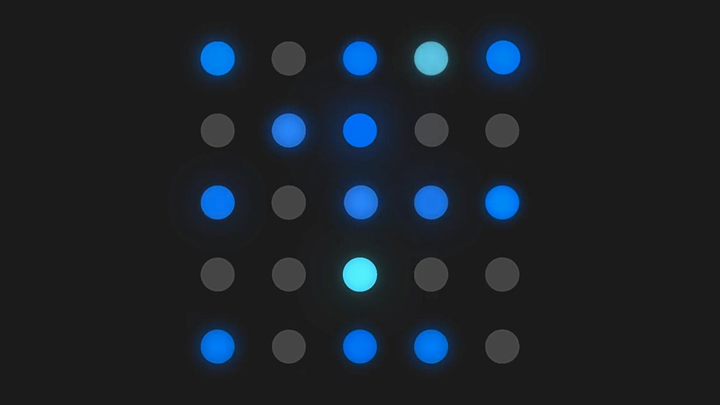 Blue and grey dots arranged in a grid pattern on a dark grey background