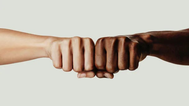Two fists of different races