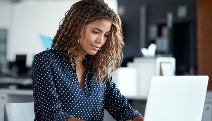 a woman interacting with a laptop