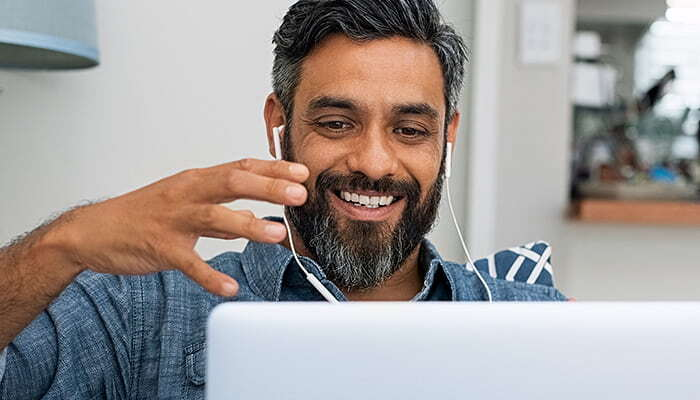 man with a laptop on an online meeting