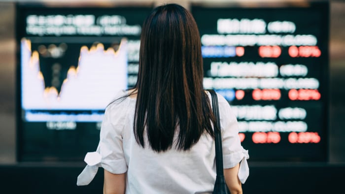 woman looking at stock market