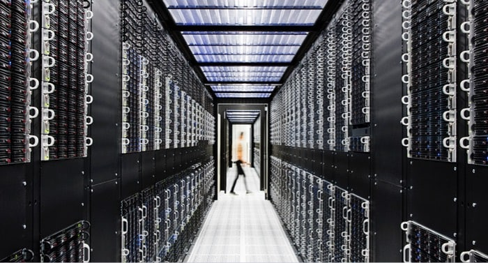 Large server room with person in the distance