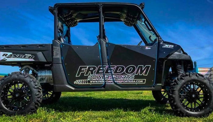 Side view of Freedom Powersports vehicle