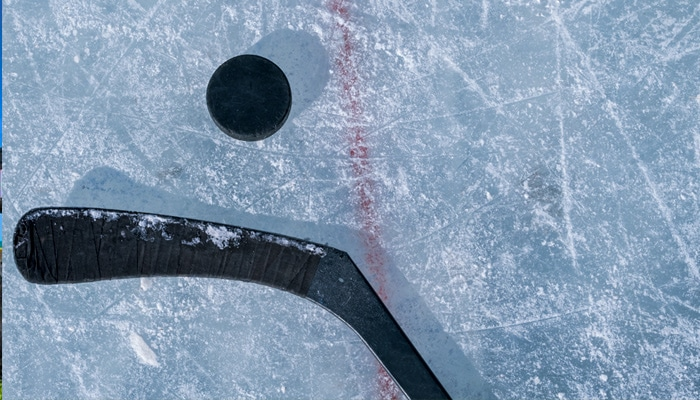 Close up shot of hockey stick and puck