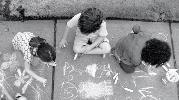 3 children drawing on the floor