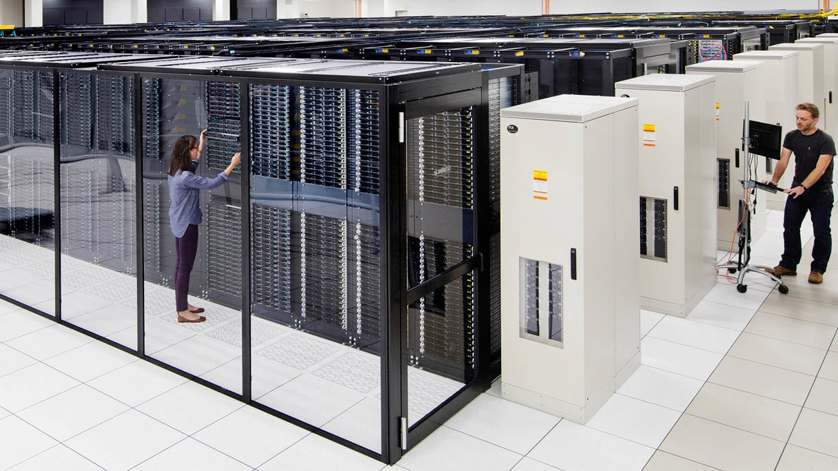 Two workers in server room
