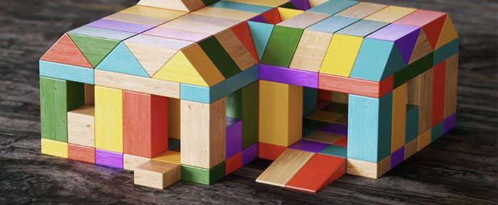 Small, multicolored structure composed of wooden blocks