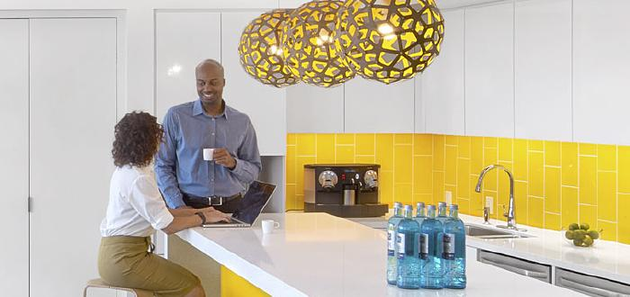 Photo of two people in a bright kitchen representing the Delos and IBM Cloud case study