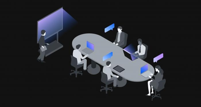 Office workers meet at a conference table